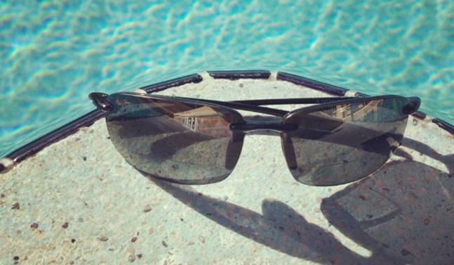 sunglasses lying poolside