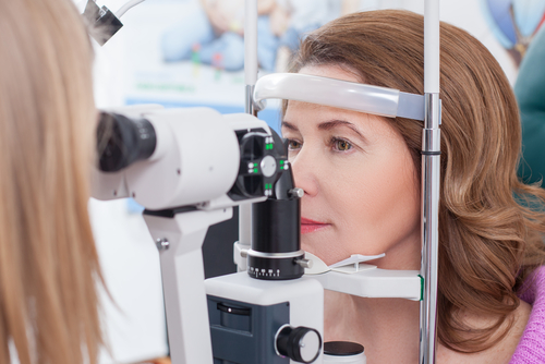 Eye exam for middle aged woman
