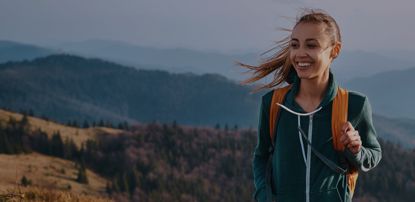 woman hiking on a trail