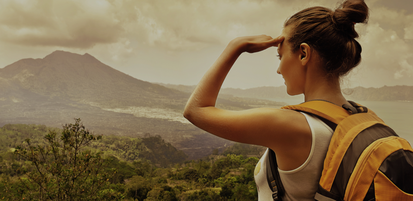 woman looking into the distance on a hike