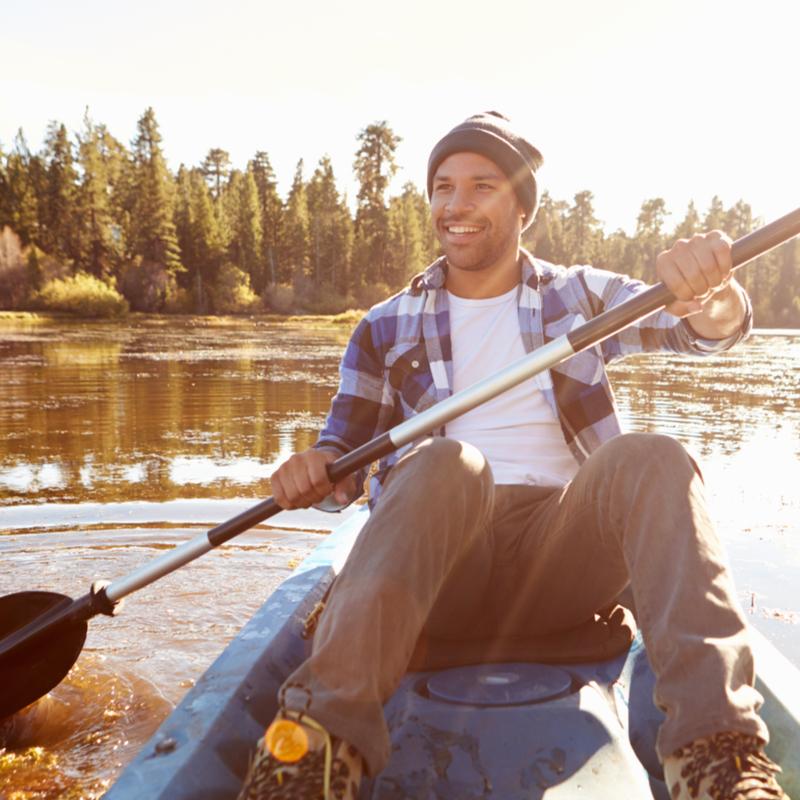 young man kayaking on river