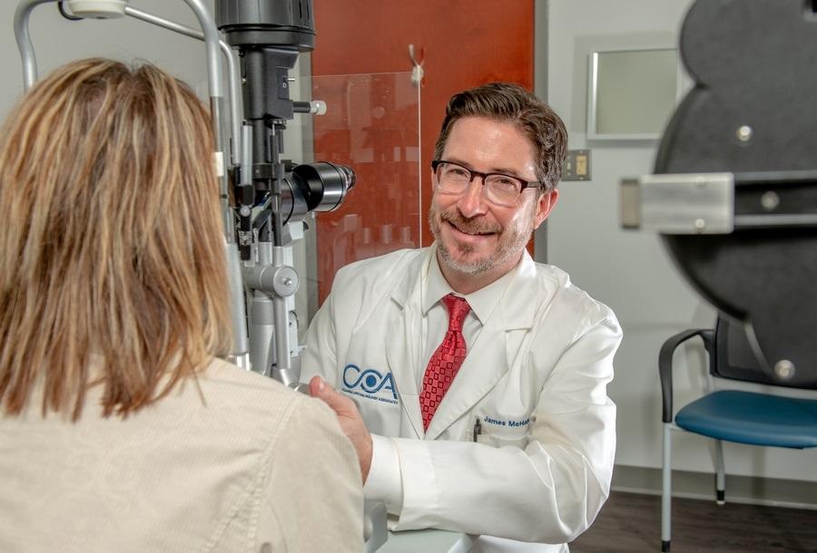 Dr. McHale doing a diabetic eye exam